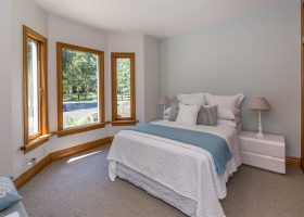 Bedroom at Bond Estate luxury group accommodation in Christchurch